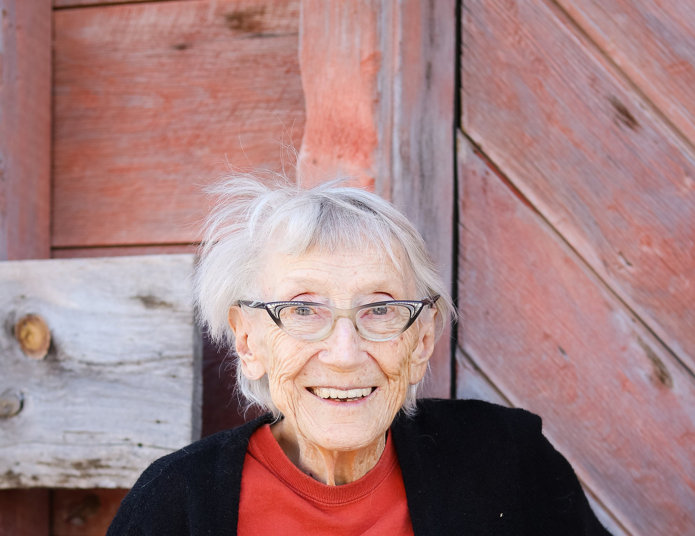 Old woman by barn